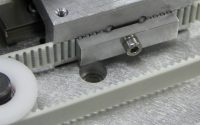 Belt clamp inside machine